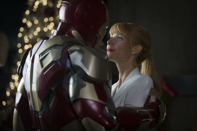 "Tony Stark/Iron Man (Robert Downey Jr.) embraces with girlfriend Pepper Potts (Gwyneth Paltrow) in ""Iron Man 3."" The movie follows the further adventures of the Marvel Comics superhero."