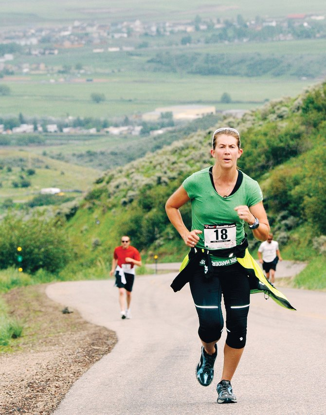 Joy Stearns powers her way up Cog Road in 2010 during the annual Hayden Cog Run. The race kicks off this year's Steamboat Springs Running Series at 10 a.m. Saturday in Hayden.