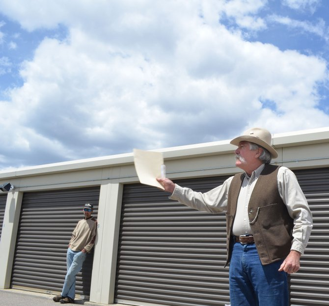 Auctioneer John Fisher tried to drum up enthusiasm for the contents of a storage locker on Steamboat Springs' west side but settled for a high bid of $25 from the customer in the background. It turned out to be a good investment. There were more than 20 people attending two auctions Thursday.