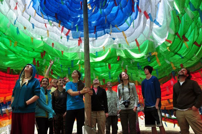 The Lowell Whiteman School students admire colors inside a prayer flag stupa in China.