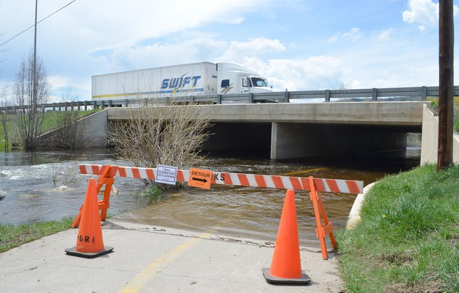 Walton Creek, which drains portions of Rabbit Ears Pass, has flooded the Yampa River Core Trail underpass beneath U.S. Highway 40 as it does every spring. A federal hydrologist said Tuesday that the Elk River likely will peak this week, and the Yampa River could peak on or around May 23.