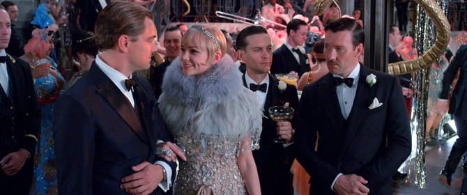 "Jay Gatsby (Leonardo DiCaprio) guides Daisy (Carey Mulligan), Nick (Tobey Maguire) and Tom (Joel Edgerton) around his mansion during a party in ""The Great Gatsby."" The movie is an adaptation of F. Scott Fitzgerald's classic novel about a millionaire attempting to woo back his former love."