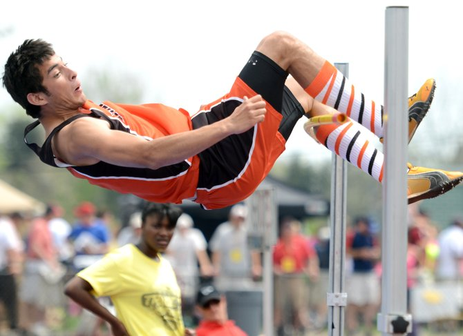 Hayden senior Jorge Valdez catches the high jump bar with his leg Saturday at the state track meet in Lakewood. He finished fifth in the event.