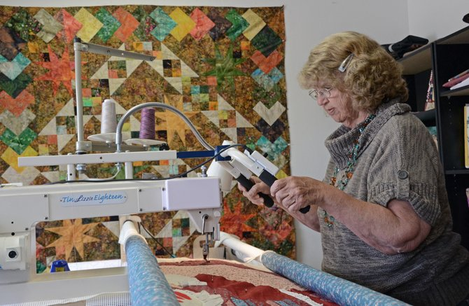 Craig resident Linda Pinnt works her longarm machine Monday at Country Rose Quilting Studio, 80 E. Fourth St., Suite 106. Pinnt recently moved her quilting business out of her home to her new location in downtown Craig.
