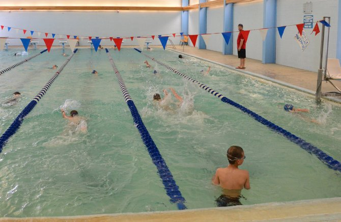 Dozens of youth swimmers churn up water Tuesday in the pool at Moffat County High School. The Craig Sea Sharks, a team for youths ages 5 to 18, has been practicing for its summer season since last week. The 2013 team is nearly double the size it was last year.