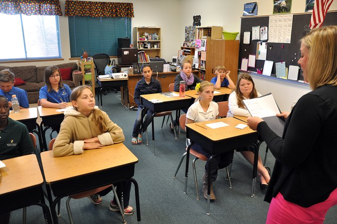 Catherine Hinson leads a fifth- and sixth-grade class Wednesday at Heritage Christian School. The campus will remain kindergarten through 12th grade next school year after a successful fundraising effort to close a large budget shortfall.