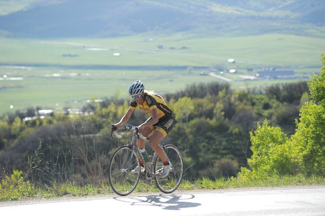Hannah Williams climbs U.S. Highway 40 on the way to the west summit of Rabbit Ears Pass on Wednesday. About 40 cyclists turned out for the time trial.