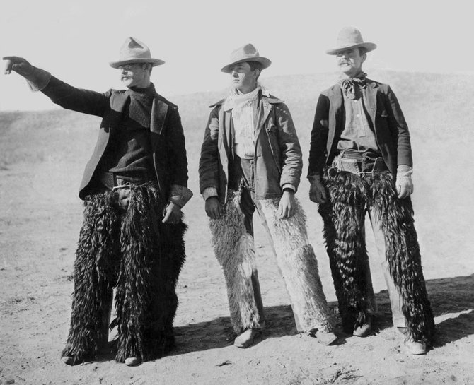 This photo, with three cowboys from Craig posing for a 'They went thata' way!' picture in the early 1900s, is one of thousands in a new book compiled by the Museum of Northwest Colorado. The book, which went on sale Monday, is titled 'Images of America: Early Craig.'