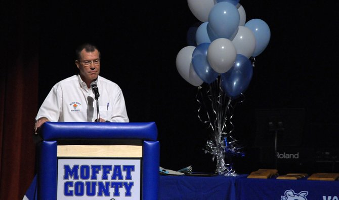 Craig Mortensen, a former teacher and coach at Moffat County High School and member of the 2012-13 Hall of Fame class, speaks about the value of athletics Thursday night at the MCHS athletic awards banquet in the school auditorium.