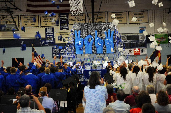 Moffat County High School's Class of 2013 tosses their mortar boards high to celebrate the end of the high school careers Saturday.