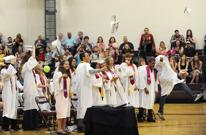 Soroco High School seniors celebrate at the end of their graduation ceremony Saturday.