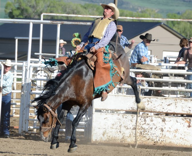 Kyler Scott, of Craig, hangs on during the ranch broncs competition of bronc riding Saturday at the Moffat County Fairgrounds. The bronc riding was a main attraction at the Wild West Weekend of Grand Olde West Days in Craig.