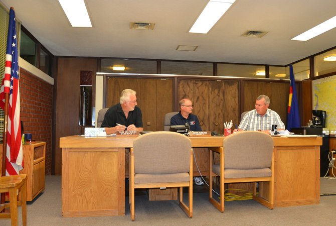 Moffat County Commissioners gather for their weekly meeting Tuesday. It was the first meeting in five weeks that all three commissioners were present. John Kinkaid, center, acknowledged Tuesday that his five-week leave of absence was to check himself into rehab for alcohol and prescription drug abuse at the Harmony Foundation in Estes Park.