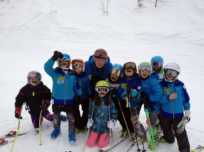 "Asher Lesyshen-Kirlan, fourth from right, is pictured with Steamboat Springs Winter Sports Club coach Bill Montag and the ""wild bunch."""