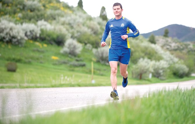 Tom Nagy runs along Elk River Road on Thursday afternoon while training. Nagy is planning to compete in the half-marathon at this Sunday's Steamboat Marathon.