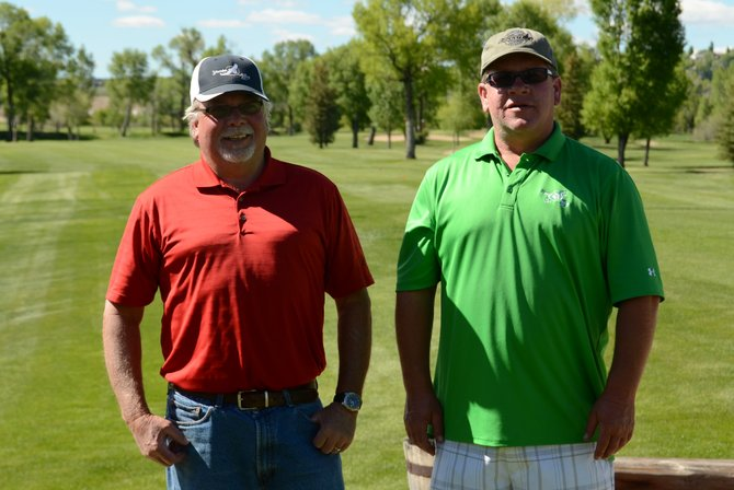 Willy Barclay, left, and Tim Boyle stand at the Yampa Valley Golf Course after winning the men's doubles tournament Saturday. They shot a 108 over 27 holes of golf to beat 11 other teams in the top flight.