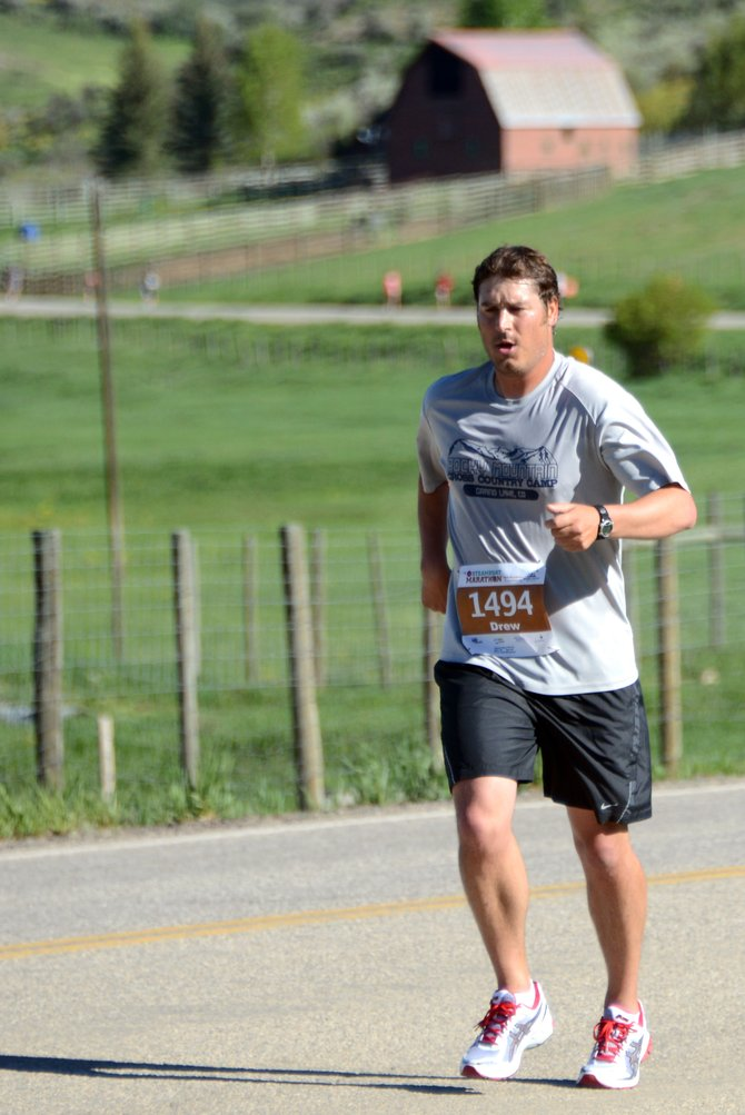 Drew Morris of Craig works his way up a hill during the Steamboat half marathon Sunday in Steamboat Springs. Morris finished with one of his best times at the distance, coming in at 1:45:40. Another 12 runners from Craig completed the half marathon Sunday.