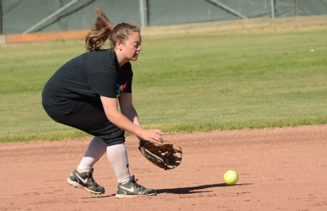 Taylor Shrode fields a ground ball during practice Wednesday. Shrode is one of two captains of the new girls fast-pitch softball team in Craig.