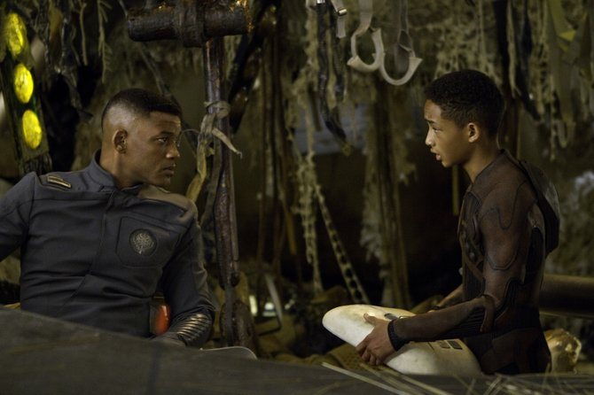 "Cypher and Kitai (Will and Jaden Smith) assess their situation in ""After Earth."" The movie is about a father and son in the distant future who crash land on a drastically different planet Earth, with the son responsible for saving his ailing father."