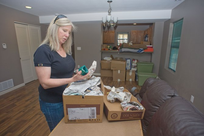 Kat Kelly and her two sons moved into their new Habitat duplex home in Riverside on May 1 and closed on the $185,000 purchase May 31.  Kelly said Thursday that it truly feels like home after nearly six months of living in a downtown motel.