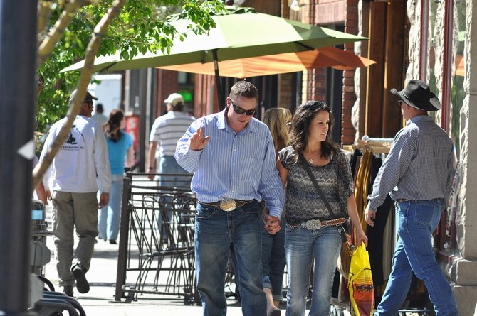 Downtown shoppers stroll along Lincoln Avenue on Sunday afternoon. Downtown stakeholders have been brainstorming ways to improve business, and some want new sandwich boards on the street to help.