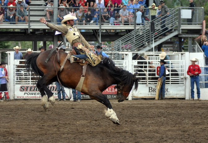 Wade Mosher hangs on during a saddle bronc riding competition in 2011's Steamboat Springs Pro Rodeo Series. This year's series kicks off Friday night.