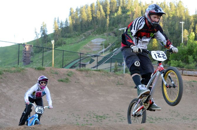 Brian Deem, right, and Gina Grether race on the BMX track at Howelsen Hill on Tuesday evening. The track will play host to its first race of the summer season Thursday.