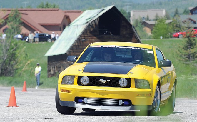 Christian Peacore rounds a corner during the Autocross event in Meadows Parking Lot during the 2013 Mustang Roundup. The Roundup will continue Saturday with a Show 'n' Shine from 10:30 a.m. to 3 p.m. on Lincoln Avenue in downtown Steamboat.