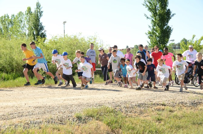 Kids take off from the starting line of the 1-mile fun run Saturday morning at Loudy-Simpson Park. Friends of Moffat County Education hosted the second annual Wake the Whittler 5K run and walk in addition to the 1-mile fun run.