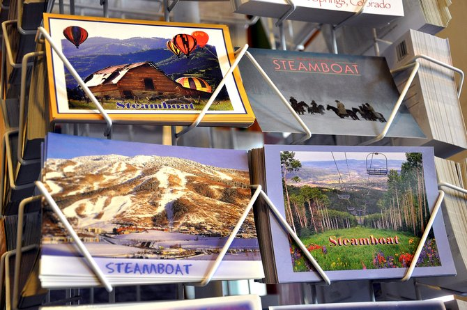 Postcards marketing Steamboat Springs in all seasons greet shoppers at the Steamboat Treasures & Tees store on Lincoln Avenue. As it starts its budget season, the city is projecting a slight gain in sales tax revenue for 2014.