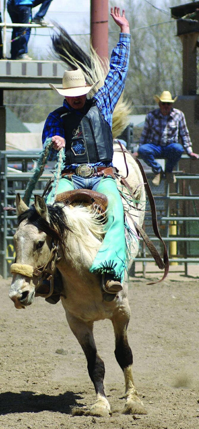 Garrett Buckley competes in bronc riding during the recent Colorado high school rodeo season. Buckley was crowned the Colorado state champion in bronc riding at the high school state rodeo June 5 through 9.