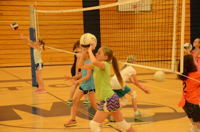 Alexa Neton practices setting and passing accurately Tuesday at Moffat County High School. Neton was one of about 60 girls from Moffat County to participate in a youth volleyball camp Monday through Wednesday.