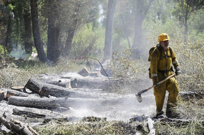 Yampa Fire Protection District firefighter Dick Sutton works at the Carpenter Ranch fire Tuesday.