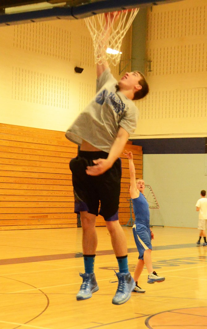 Kort Hathhorn elevates during warmups at an open gym at Moffat County High School this week. Hathhorn is an incoming sophomore and one of a large group of returning players who will compete for playing time this summer.