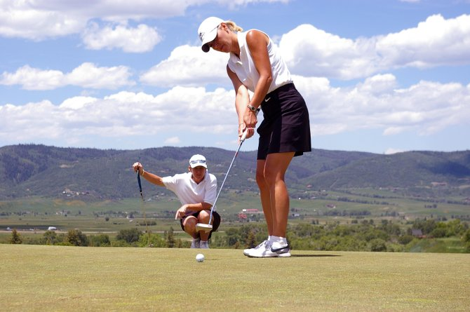 Cheri Scully putts for birdie while Shannon Hanley watches the line Saturday on the 17th hole at Catamount Ranch & Club. The team of Scully, Hanley, Amy Hillenbrand and Toni Hennessey shot a 245 over two days to record the second best score in the tournament and win Flight B.