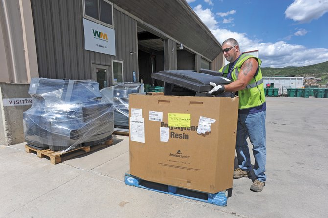 Waste Management employee Tony Nanio loads a television into a box while preparing a load of used electronic equipment to be shipped from Steamboat Springs to the Waste Management Recycle America center in Denver. The company regularly sends outdated and unused electronics, which cannot be deposited in local landfills, to Denver where they can be properly recycled.