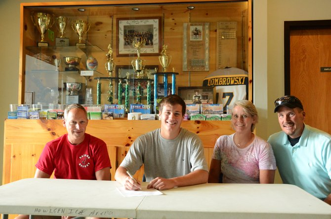 Jarret Walt, a 2013 graduate from Moffat County High School and member of the Steamboat Springs High School hockey team, signed to play junior hockey with the Chicago Jr. Bulldogs of the North American Tier III Hockey League. Walt was joined by his coach Jeff Ruff, left, and parents Joanie and John.