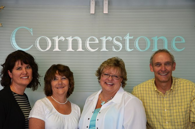 Stacey Mathers, left, Kim Cox, Sari and Chuck Cobb stand inside their warm and welcoming business called Cornerstone Reality. The company won best real estate agency in this year's Best of Moffat County.