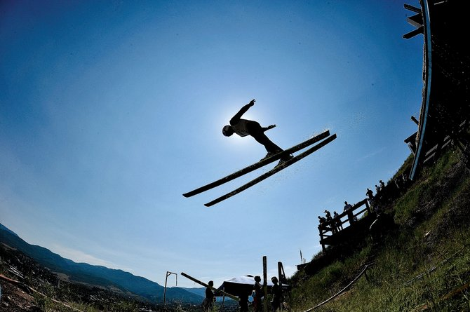 Nordic combined skier Cliff Field takes flight off a plastic-covered ski jump during the jumping portion of the 2012 Fourth of July Ski Jumping Extravaganza in Steamboat Springs.