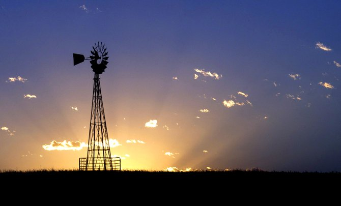 A windmill stands against the sunset in a western Kansas pasture on Saturday evening.