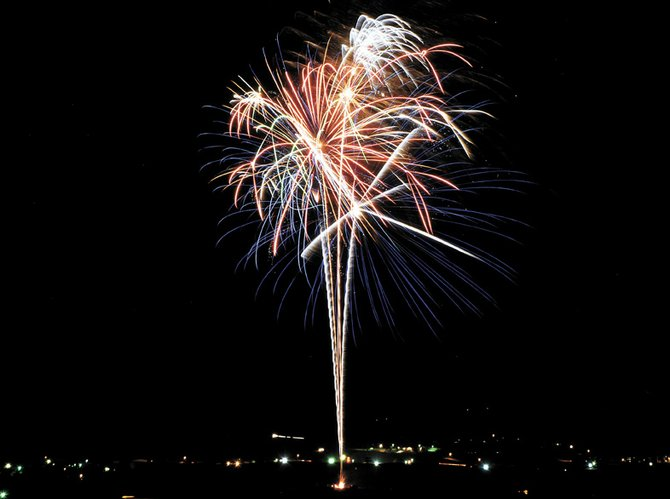 Fireworks explode in the night sky over Craig in 2011. Despite the Stage 1 fire restrictions enacted by the Bureau of Land Management and Moffat County, the Fourth of July fireworks show will go on as scheduled at Moffat County High School.