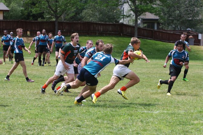 The Steamboat Springs Rugby Club, seen here wearing the green and orange uniforms, jumped out to a 27-point halftime lead against Glenwood Springs during the weekend en route to a 53-18 victory and a 2-0 start to the season.