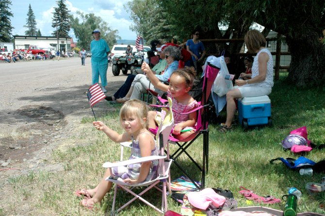 Three-year-olds Gracey Keller, front, and Maya Peilet celebrate the Fourth of July at the parade in Yampa.