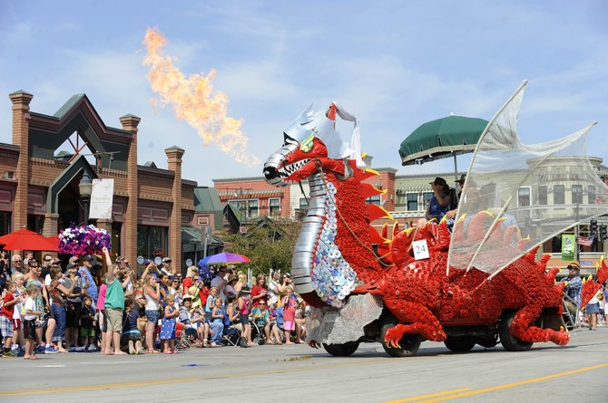 Steamboat Springs resident Charlie Holthausen's dragon spits fire during the July 4 parade on Lincoln Avenue.
