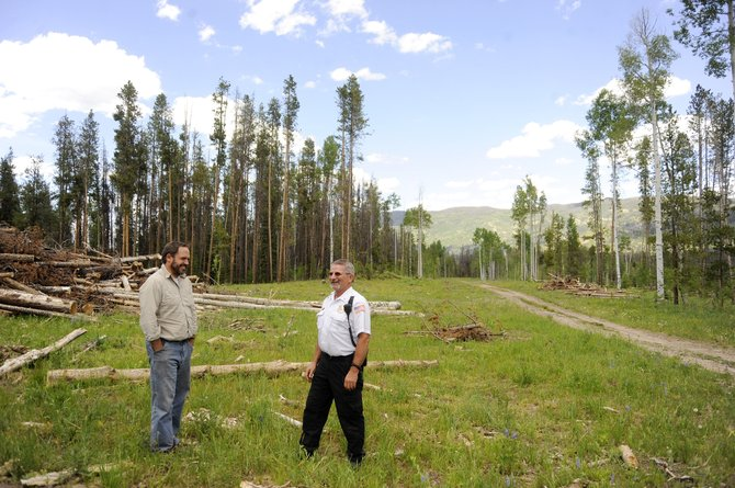 Stagecoach property owner Robert Skorkowsky, left, and Oak Creek Fire Protection District Chief Chuck Wisecup toured the Stagecoach neighborhoods in late June to evaluate the logging work that had been done to help mitigate the risk of a wildfire. Most of the work consisted of removing 178 acres of dead trees from along the miles of roads.