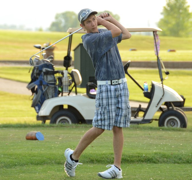Casey Nations follows his tee shot on the seventh hole at Yampa Valley Golf Course. Nations and teammates Moe Ortega, Mimi Ortega and Marilyn Rieser played in the TGIF Hawaiian Luau Scramble at the golf course Friday night, shooting 39 as a team.