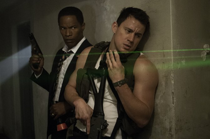 "John Cale (Channing Tatum) protects the president of the United States (Jamie Foxx) in ""White House Down."" The movie is about a terrorist takeover of the White House and one man's efforts to save the nation."