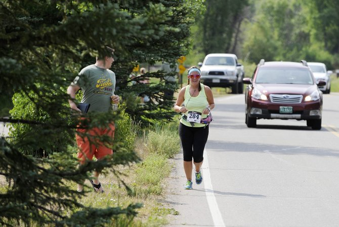 Broomfield resident Jody Smith approaches the finish line of the half-marathon during the Mountain Madness Steamboat Springs Running Series event Saturday.