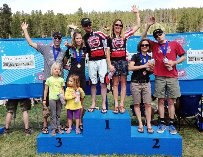 Nate Bird and Jaime Brede stand atop the podium after winning the co-ed duo division of the Breckenridge Firecracker 50 mountain bike race Thursday. The pair helped lead the way for a strong contingent of Steamboat Springs riders.