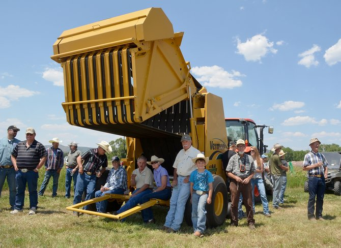 Members of the agricultural community gather at the Carpenter Ranch on Wednesday during Northwest Colorado Hay Day to check out the latest, greatest machinery for harvesting the crop.